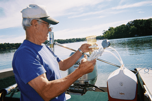 Volunteer Taking Water Quality Samples